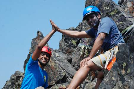Two climbers high-five at the Tooth