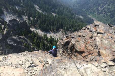 A climber near the top of the tooth near Snoqualmie Pass