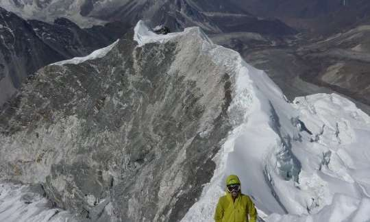 A climber on the Island Peak Summit Ridge