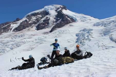 climbers taking a break while climbing Mt Baker