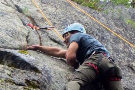 A climber learning to rock climb outdoors