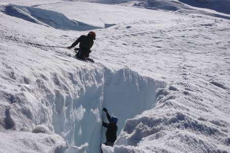Two climbers practice crevasse rescue