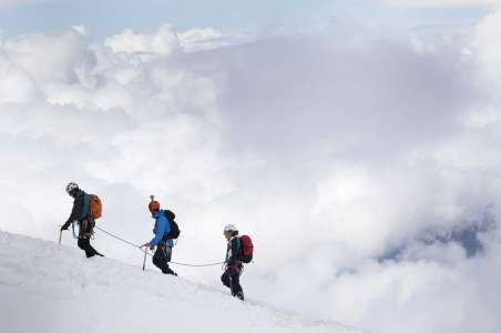 Denali Climbers in front of clouds