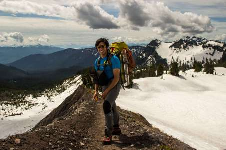 A climber smiles while climbing Mt Baker