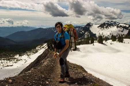 A climber smiles while climbing Mt Baker