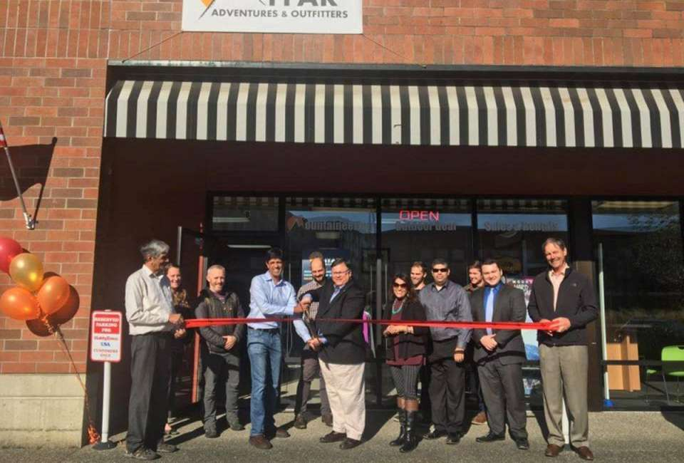 Redmond Mayor John Marchione cuts the ribbon at Miyar Adventures' opening this month.