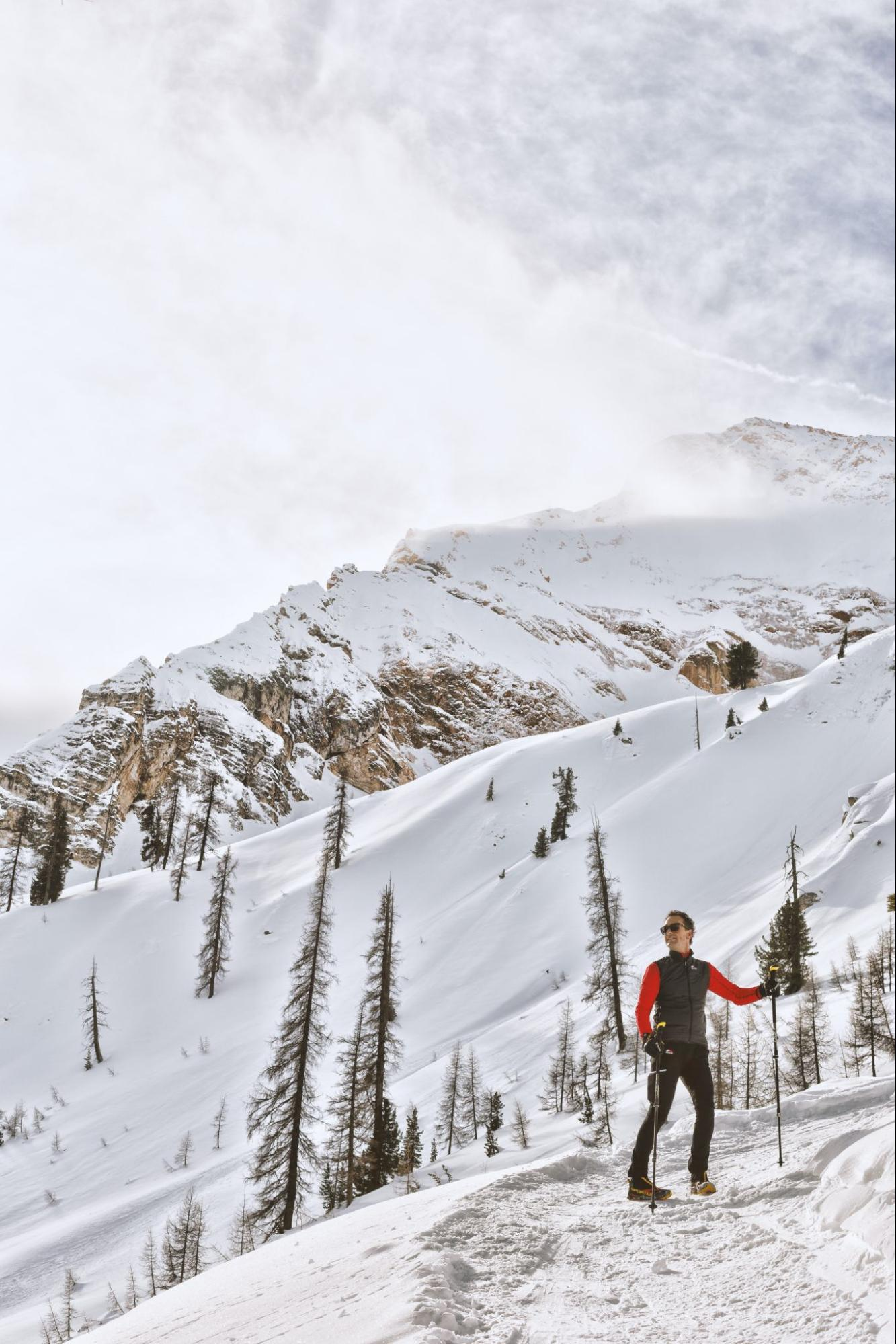 winter-hiker-on-path-in-the-alpine